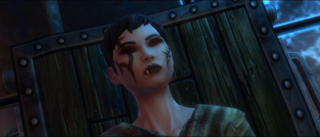 A short-haired woman with scars on her face has her eyes closed. Kingdom of Amalur: The Reckoning, 38 Studios/Big Huge Games, Electronic Arts/38 Studios, 2012.