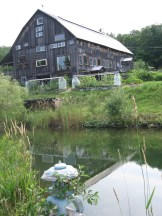 Pond view of barn