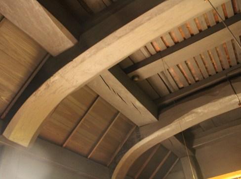 Oak beams curved at the base