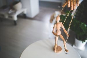 Ideas for plastic-free party bags - something to do. Wooden toy figurine.