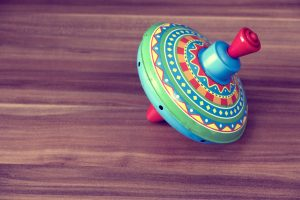 Ideas for plastic-free party bags - wooden spinning top.