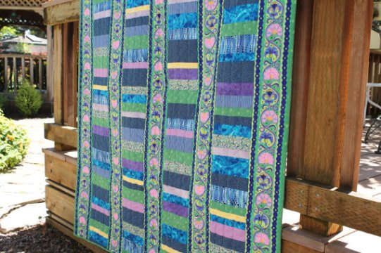 http://www.etsy.com/listing/93714837/modern-lap-quilt-in-beautiful-unique
