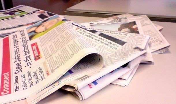 13. Get a Streak-Free Shine with Newspaper