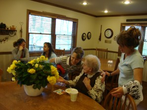 Jody, Gramma and Laurie admiring some birthday flowers