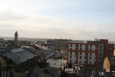 Looking over Preston, with church in for ground and the council building and records office building in background.