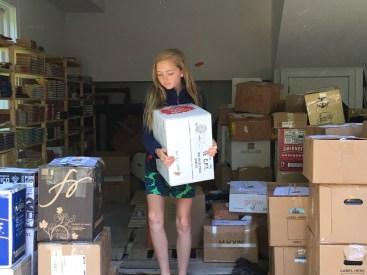 Emma carrying a box