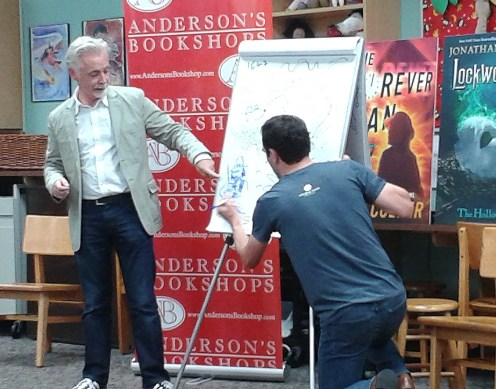Stroud helping Colfer draw the villain from Colfer's new book, The Forever Man.