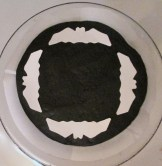 Card stock is best for making your stencils, because they'll lay flat on the cake without curling up.