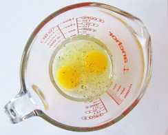 As with many egg recipes, there are lots of opinions as to whether or not you should add liquid to your omelet. Some add milk, some water, some no liquid at all. I don't recommend using milk, as it does not combine with the egg the way water does (the fat remains separated from the egg no matter how much you whisk it). Water makes the eggs lighter and fluffier, but some say adding any liquid at all reduces the flavor of the eggs. I like the texture and don't notice a difference in flavor, so I tend to go with water.