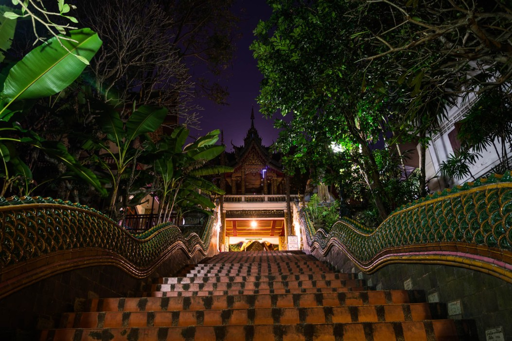 A Dragon scale and brick staircase leads up to the Doi Suthep Buddhist Temple in Chiang Mai Thailand