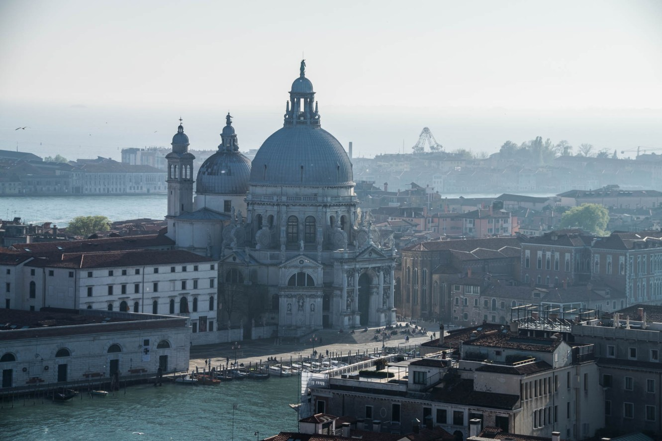 The old Venice Church Santa Maria della Salute is seen from a vantage point among the misty ocean air.