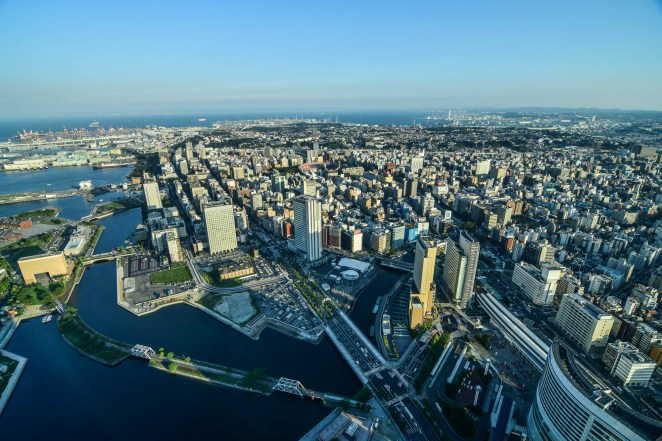 The large metropolis of Yokohama and Tokyo bay are seen from the landmark tower in Japan.