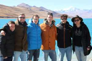 Group of visitors by the Yamdrok Lake in Tibet
