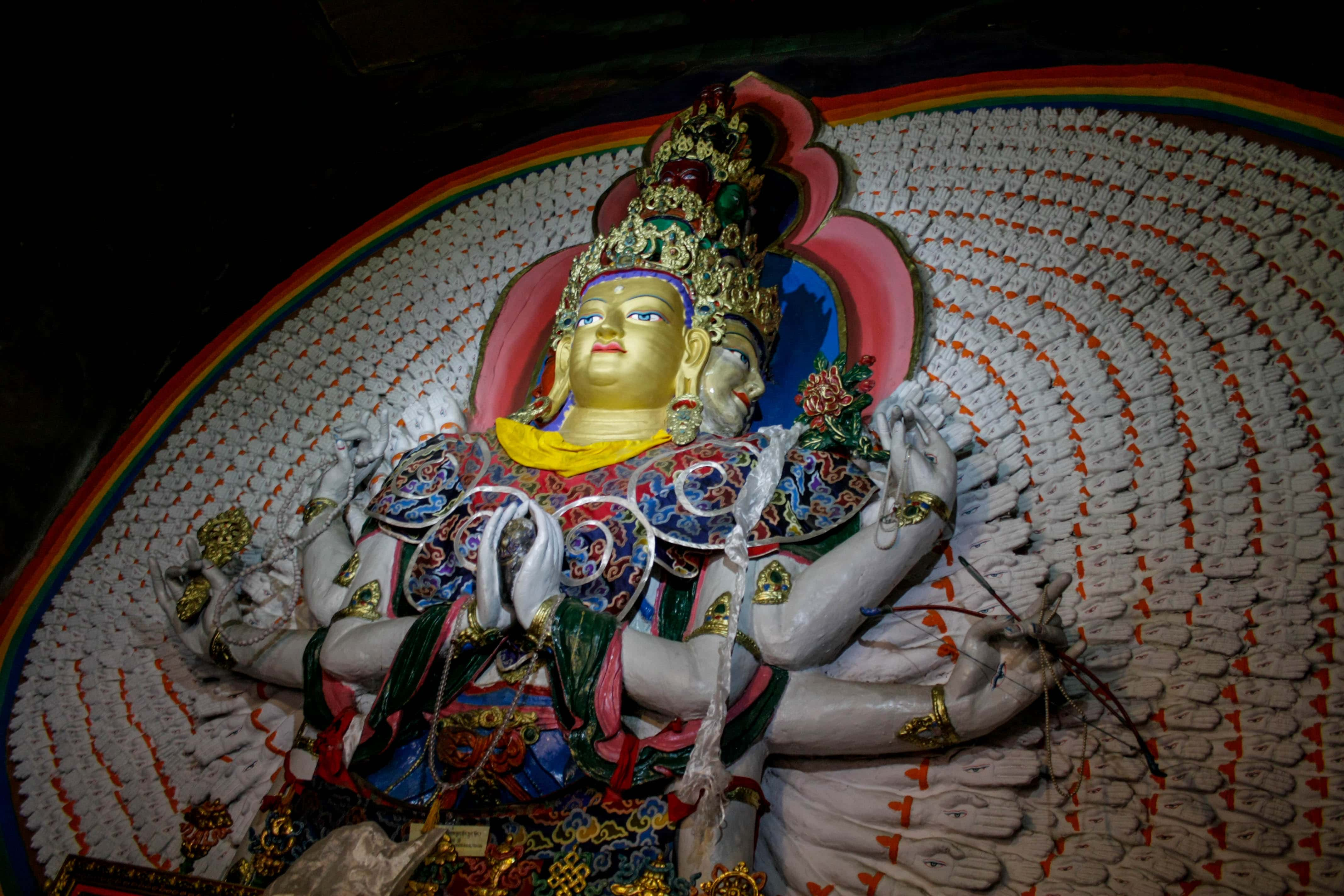 Statue of Thousand arms and eyes compassion Buddha Chenrezig in Samye monastery