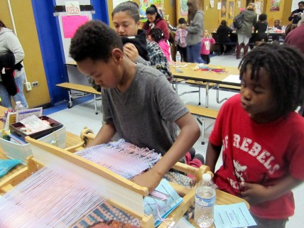 Student learns about loom weaving