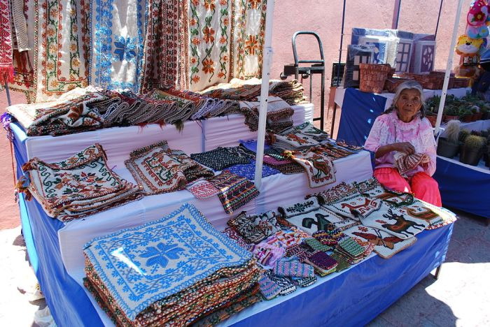Women selling embroidered works at a stall in Tequisquiapan
