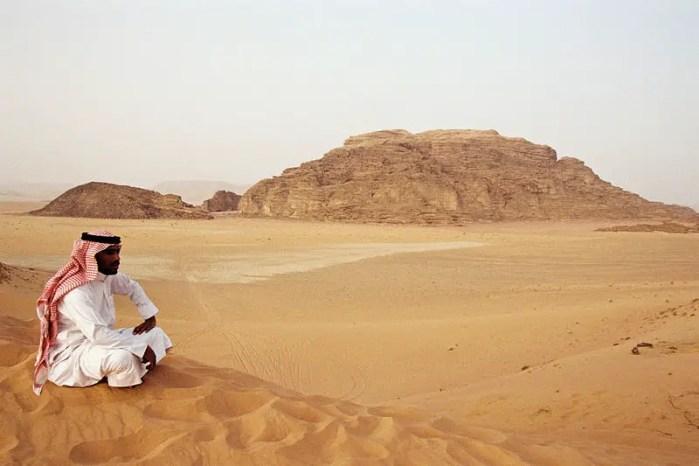 Bedouin sitting on sand dunes of Wadi Rum