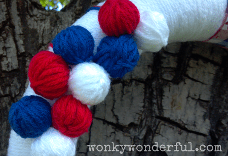 close up of red, white and blue yarn balls