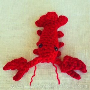 crocheted small red crawdad with black eyes
