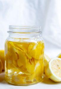 lemon peels and clear vinegar in glass jar