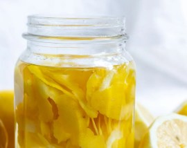 lemon peels and clear vinegar in glass jar