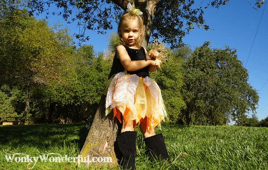 sassy little girl wearing scrap skirt with black boots and a black tank top