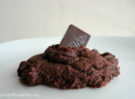 close up of chocolate cookie with mint square sticking out