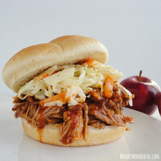 bbq pulled pork with cabbage slaw on a hamburger bun