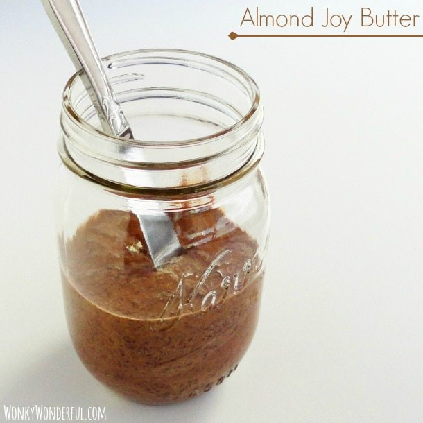 brown nut butter in glass jar with silver knife