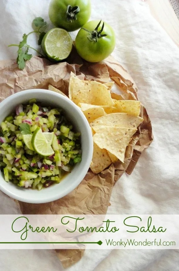 green chunky salsa in white bowl with chips and green tomatoes on the side, photo text: green tomato salsa
