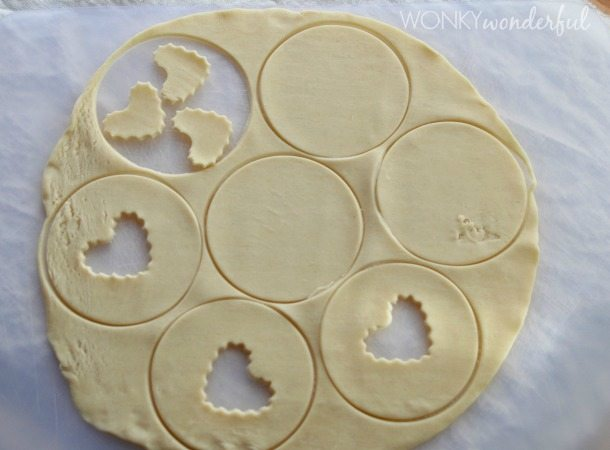 rolled out uncooked pie crust cut into circles and hearts