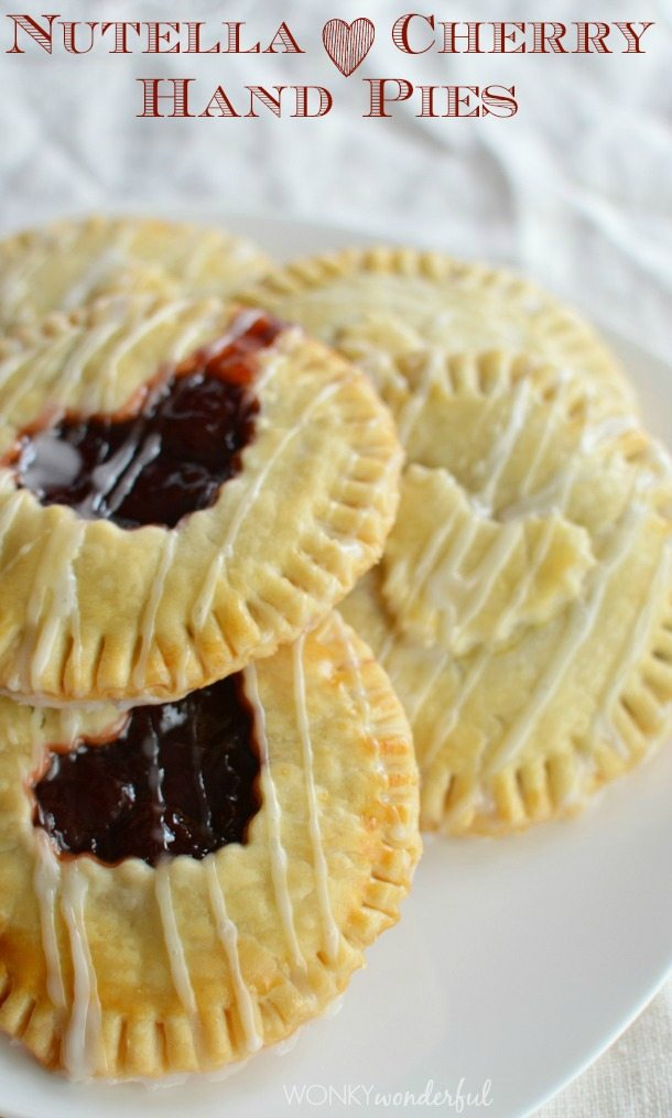mini hand pies with heart shaped cut out on top - photo text: Nutella cherry hand pies