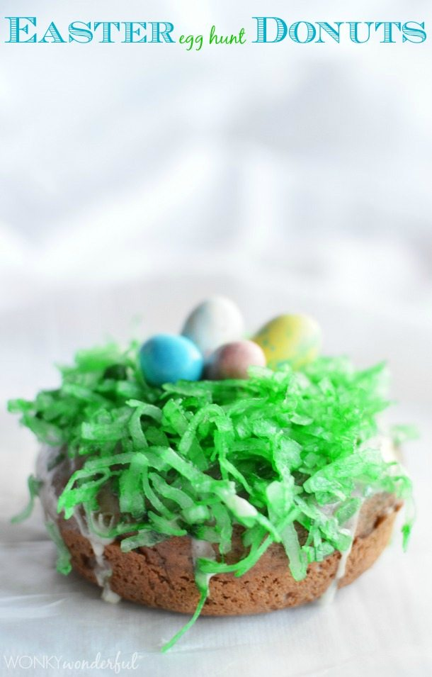 brown donut topped with green colored coconut and robin egg candy - photo text: Easter egg hunt donuts