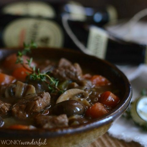 closeup of beef stew in brown bowl