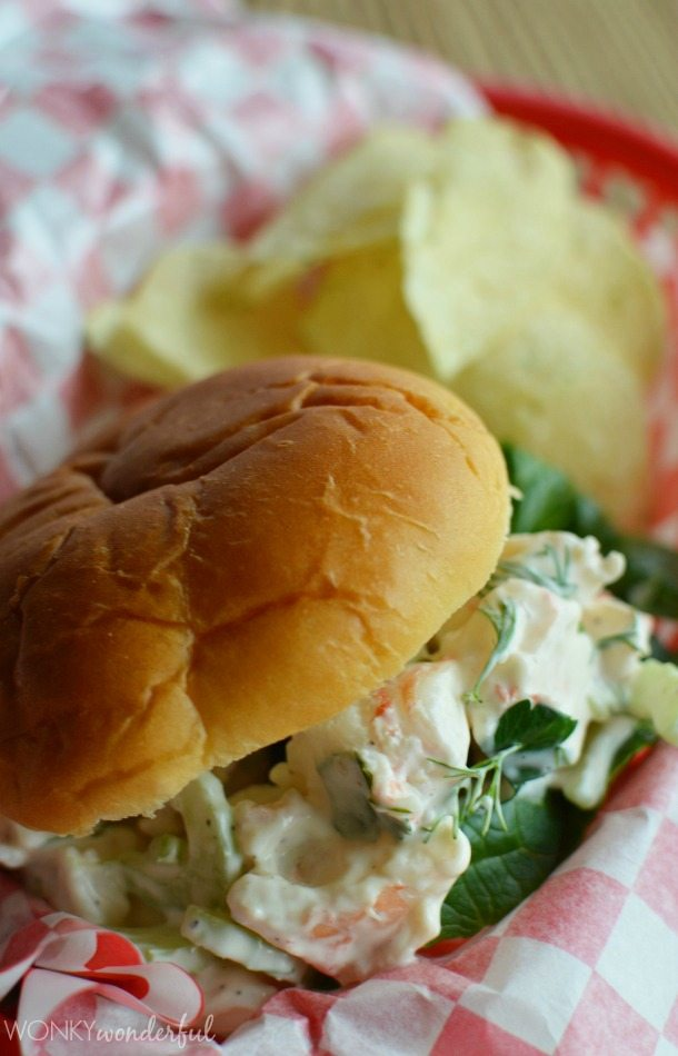 soft sandwich roll filled with creamy shrimp salad