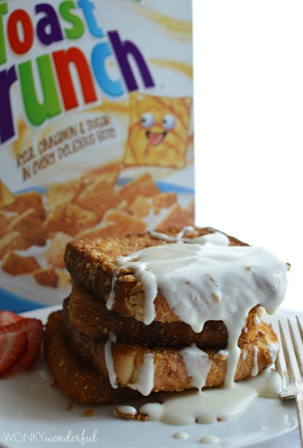 prepared stack of glazed toast in front of cereal box