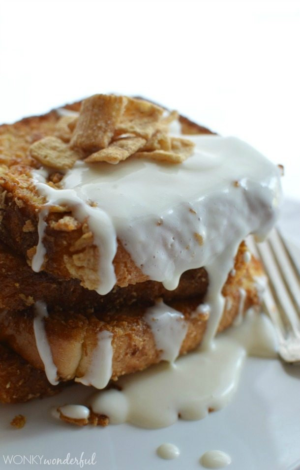 stack of French toast topped with cereal and white glaze