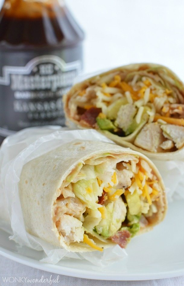 chicken wraps with bottle of barbecue sauce in background