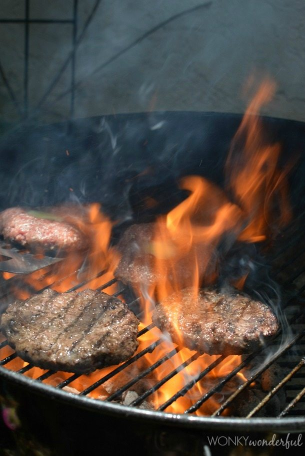 grilled burgers on a fiery bbq