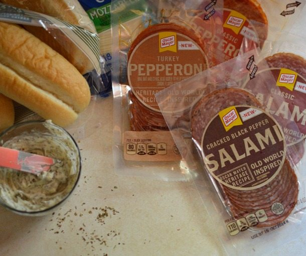 ingredients for hot italian sandwiches, salami, pepperoni, rolls