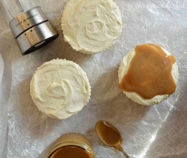 Mini Eggnog No Bake Cheesecake Recipe. Individual Cheesecakes flavored with eggnog and topped with Salted Eggnog Caramel Sauce! Holiday Dessert!