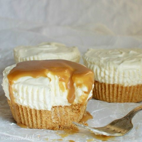 partially eaten small cheesecake topped with caramel