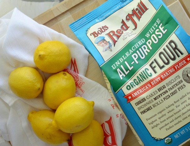 package of organic flour next to yellow lemons