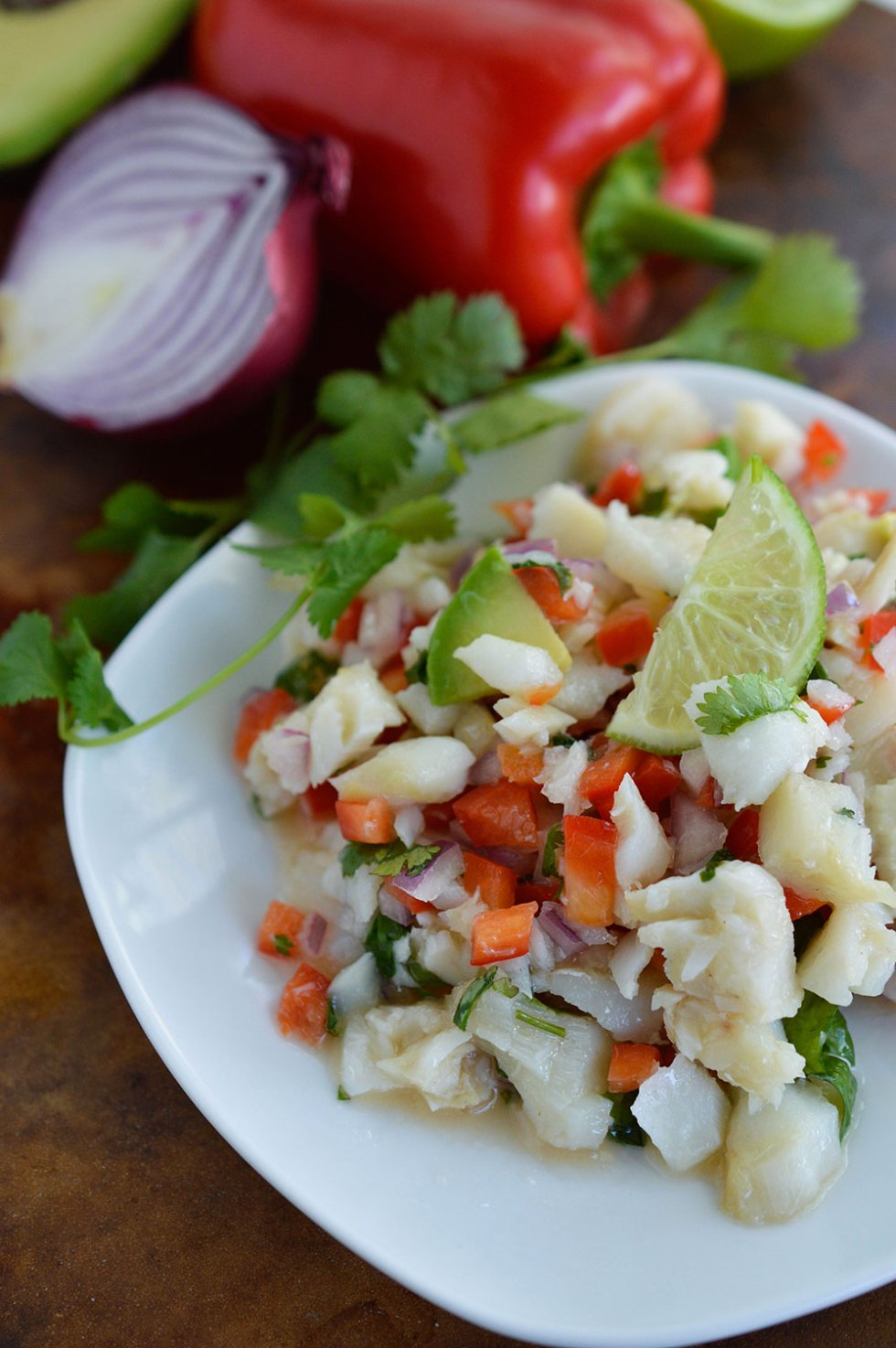 Salted Cod Recipe inspired by a Caribbean favorite (bacaloa). Salt and cod fish combined with fresh ingredients for a unique dish. #whole30recipes #paleorecipes