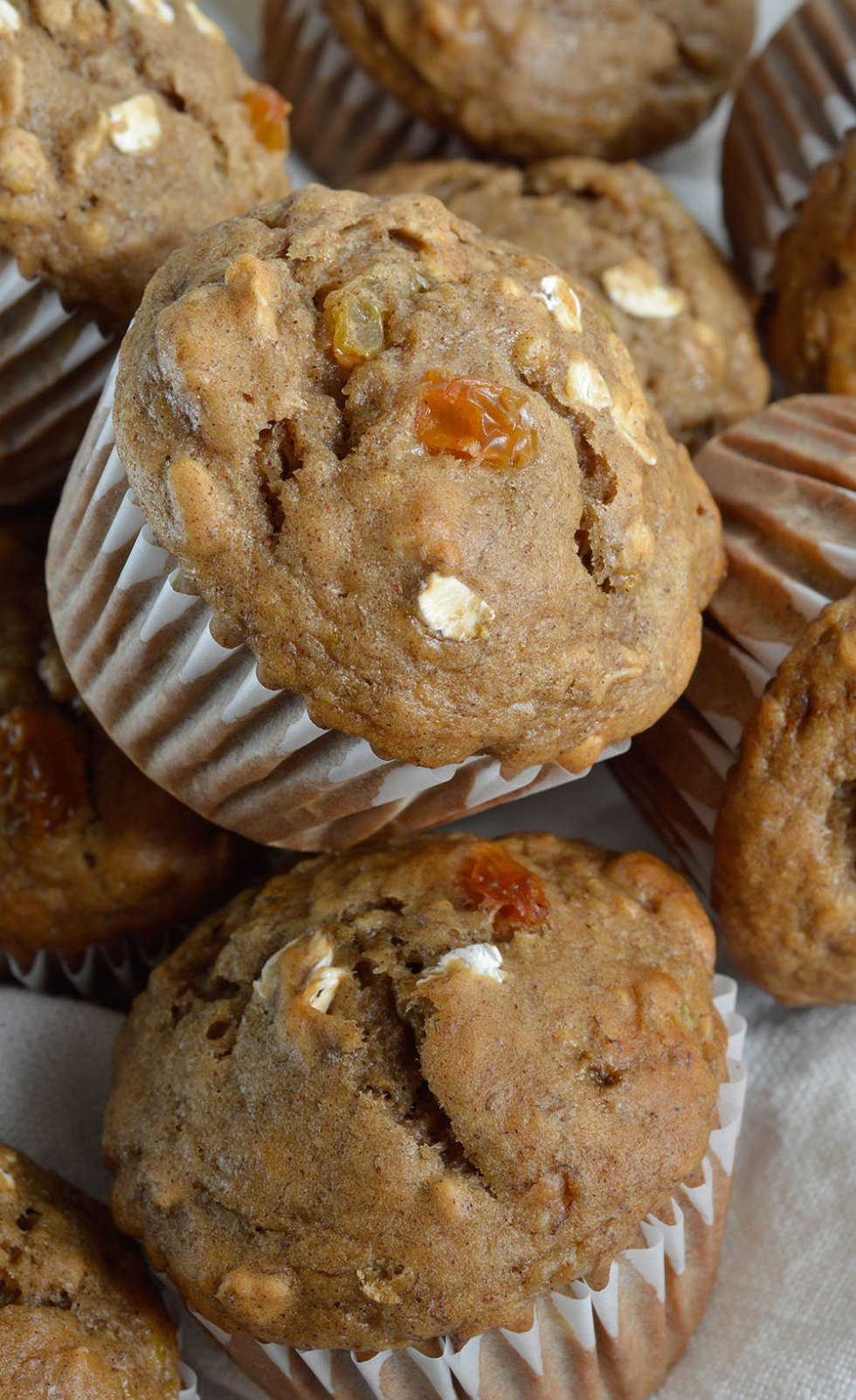 stack of banana bread breakfast muffins with white muffin liners