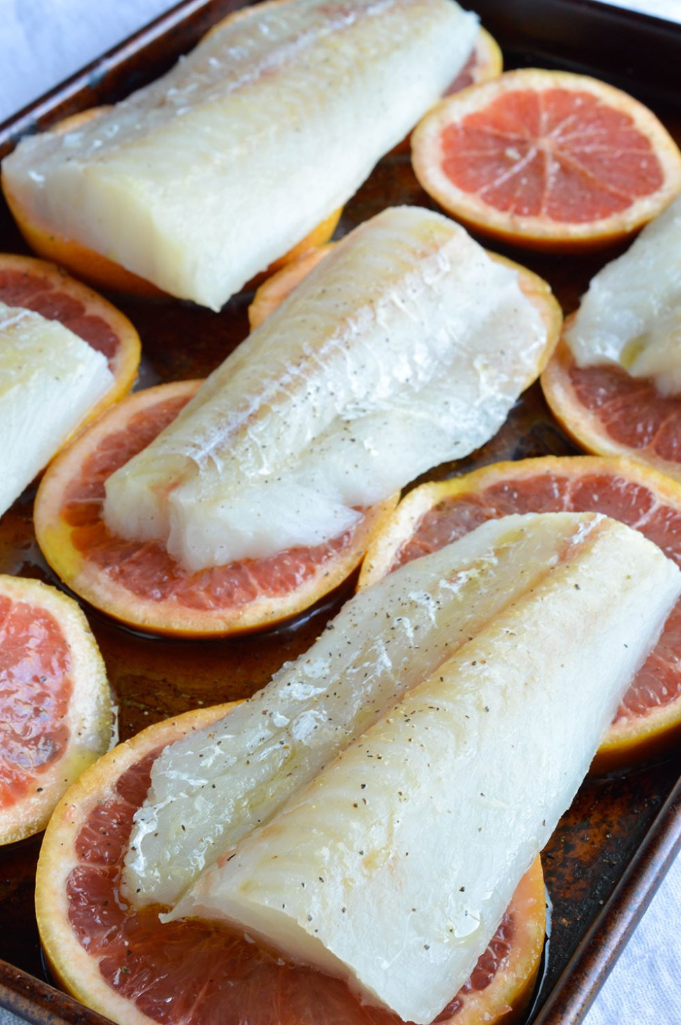 Grapefruit and Honey Glazed Baked Cod Recipe with Creamy Coconut Rice. This bright dinner is quick and easy. Say Goodbye to boring old fried fish and Hello to healthy, flavorful oven baked cod fillet!