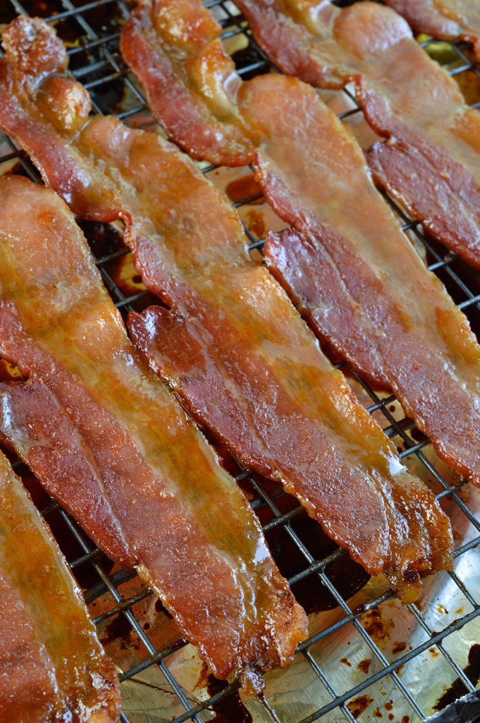 Sriracha and Maple Glazed Oven Baked Bacon - This is a sweet and spicy snack that everyone will love! Great for breakfast too.