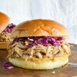 Slow Cooker Honey Mustard Shredded Chicken Sandwich Recipe - This easy dinner is made in your crockpot with just 4 ingredients! A pulled chicken sandwich with sweet and tangy honey mustard flavor!