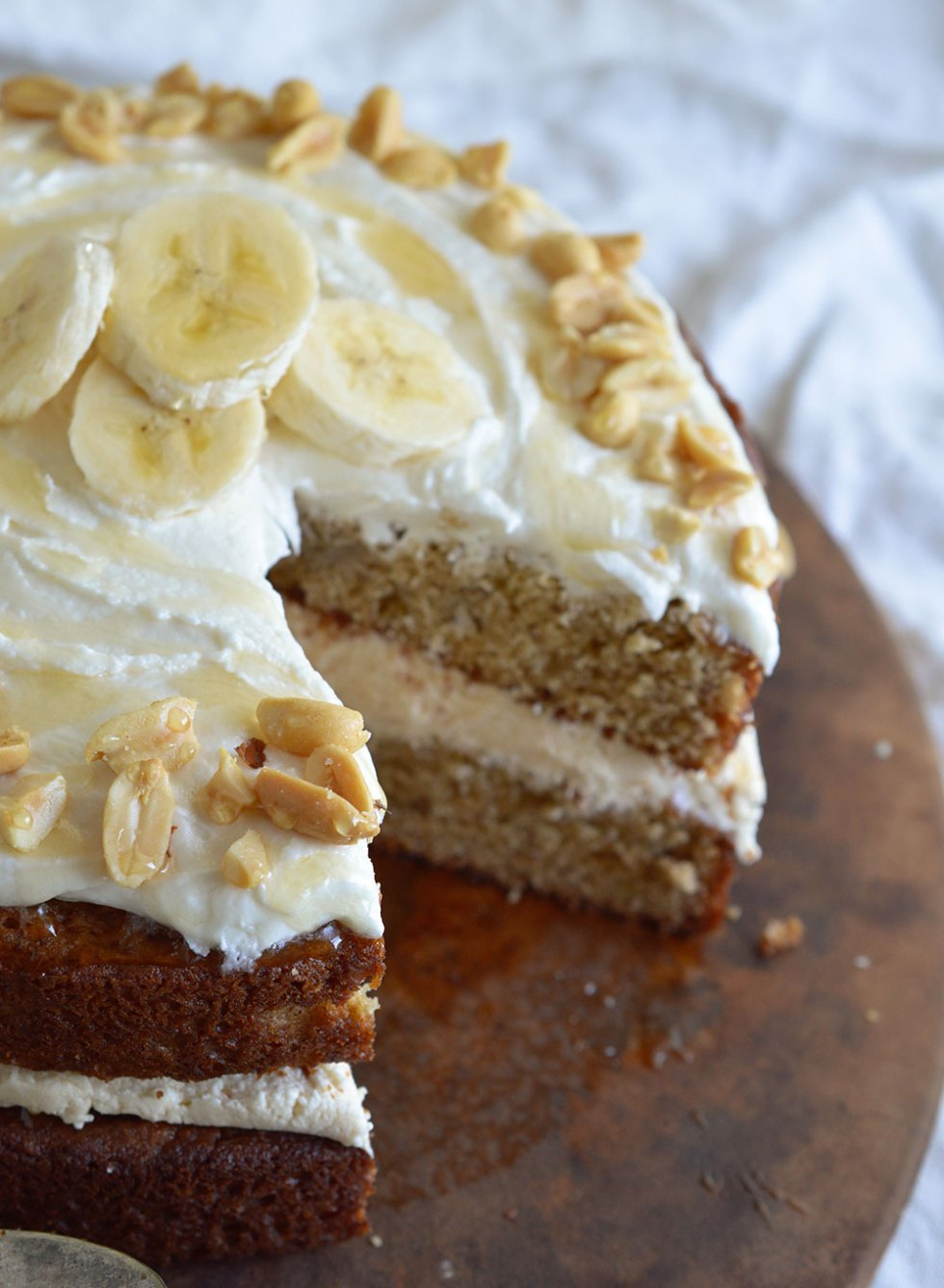 Banana Layer Cake with Peanut Butter and Honey Frosting. This fun and easy naked layer cake will take you back to your childhood! The perfect blend of peanut butter, honey and banana in one impressive dessert recipe!