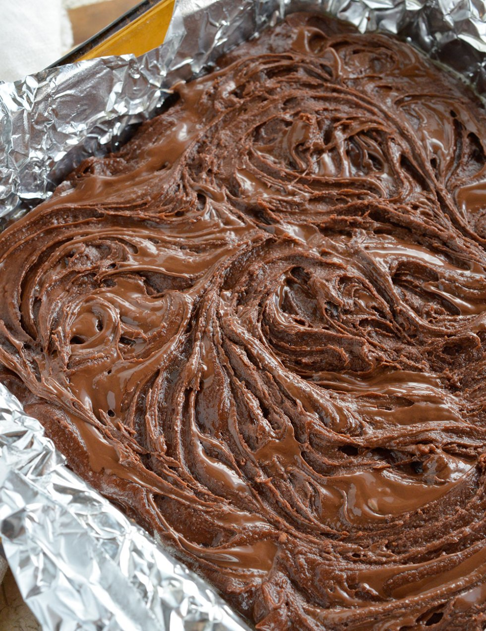 This Chocolate Chunk Nutella Brownies Recipe is an easy and delicious chocolate dessert! Fudgy brownies packed full of chocolate chunks then topped with a Nutella swirl. Perfect for potlucks, picnics or just because!